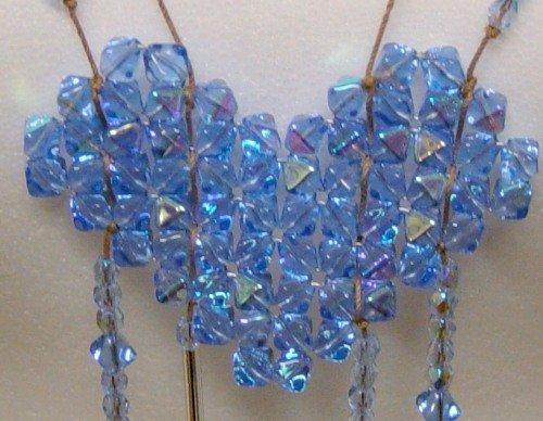 foto del ciondolo Corazon, creazione di bijoux con la tecnica intreccio